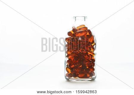 Bottle With Gelatin Capsules On White Background