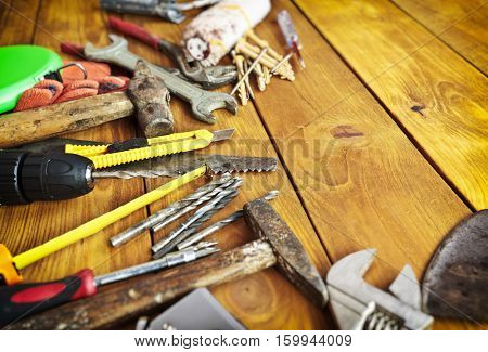 Set of different building equipments on the wooden table