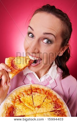 happy young woman eating piece of tasty pizza