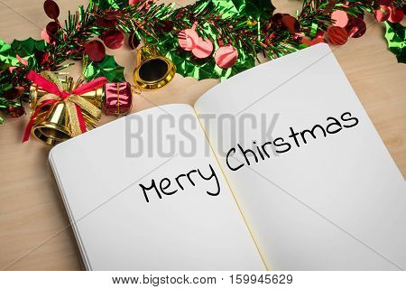 merry christmas word in note book with christmas decoration for christmas holiday.