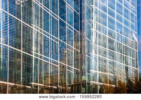 Multiple exposure effect image. Canary wharf office buildings view