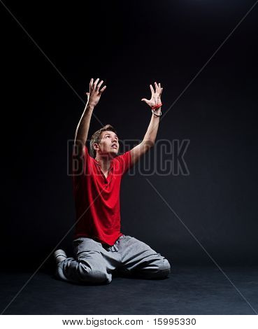 man sitting on the floor and looking up