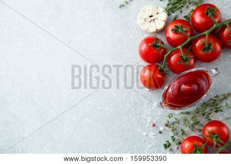 Tomato Ketchup Sauce With Garlic, Spices And Herbs With Cherry Tomatoes In A Glass Bowl On Stone Tab