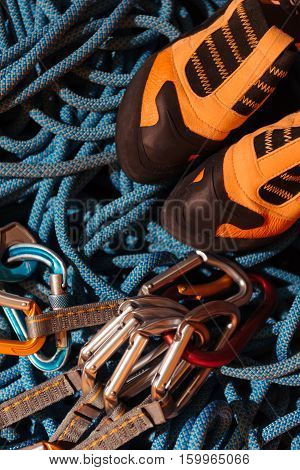 Be ready. Close up of insurance ropes and boots for climbing as special equipment.