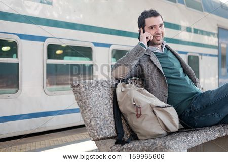 Man Talking On The Phone In A Train Station Platform