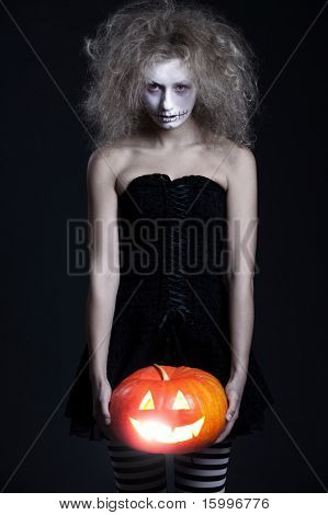 halloween portrait of ghost with orange pumpkin