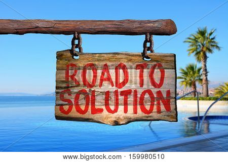 Road to solution motivational phrase sign on old wood with blurred background
