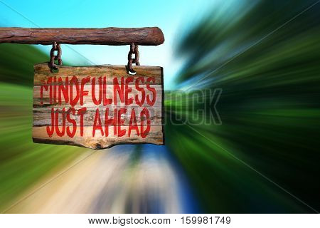 Mindfulness just ahead motivational phrase sign on old wood with blurred background