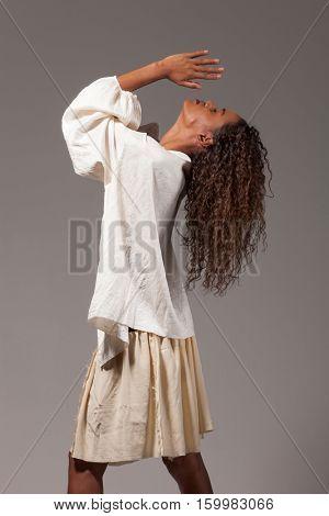 beautiful brazilian girl portrait, isolated on gray