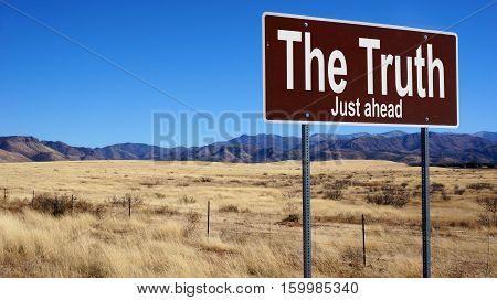 The Truth road sign with blue sky and wilderness