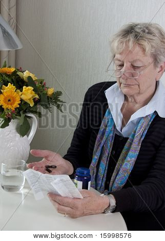 Senior woman taking medication