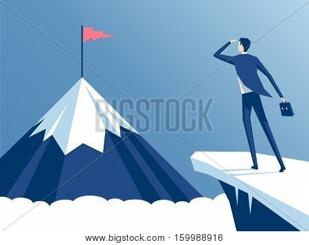 businessman standing on cliff's edge and looking at the mountain on which he will climb an employee looking for a way to his goal business concept challenge and the goal