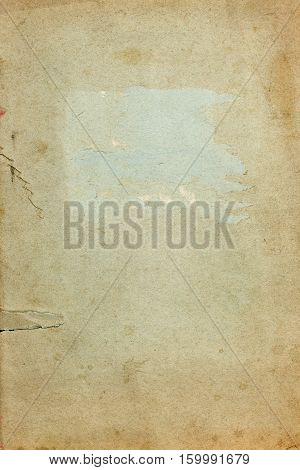 Old stained torn copybook cover paper page