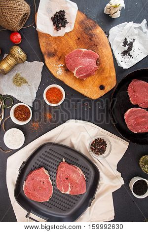 Cooking Dinner. Overhead Pieces Raw Pork Steaks And Condiment
