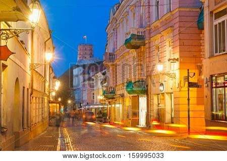 Gediminas Tower or Upper Castle as viewed from Pilies Street with luminous track from the car at night, Old Town of Vilnius, Lithuania, Baltic states.