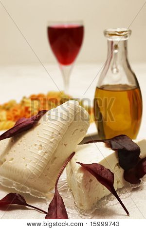 feta cheese and olive oil and wine glass