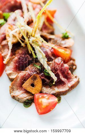 beef with vegetable garnish