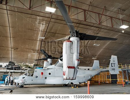 DAYTON, OHIO, USA-NOVEMBER 18, 2016:CV-22 Osprey Tiltrotor, Special Operation Forces test aircraft, combines features of helicopter and turboprop. Shown here in National Museum USAF restoration area.