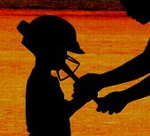 picture of little-league  - A coach reaches down to show a little player how to hold a bat - JPG