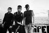 Three Rap Singers Band On The Roof. Black And White Photo poster