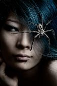 stock photo of huntsman spider  - Portrait of model with spider in hair - JPG