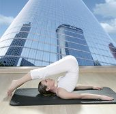 stock photo of saxy  - black mat yoga woman window view of city urban buildings - JPG