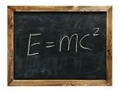 text e=mc2 drawn on a chalkboard. isolated on white