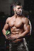 Handsome Athletic Fitness Man Holding A Shaker And Posing Gym poster
