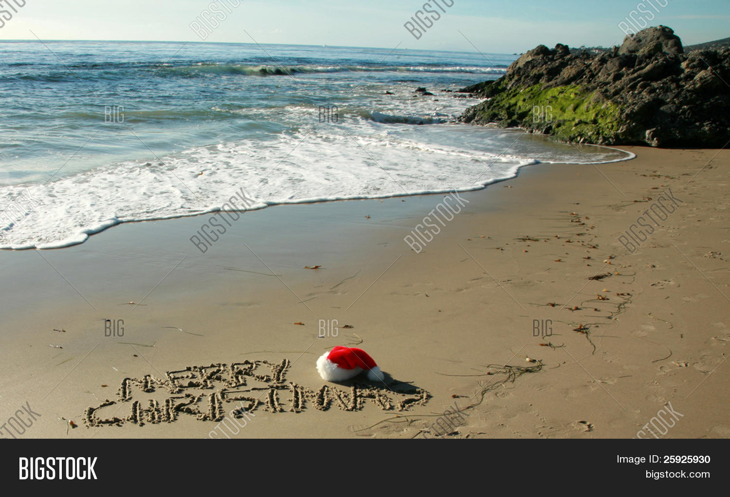 stock photo the words merry christmas written in wet sand