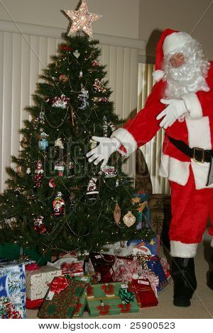 Santa shows off xmas presents