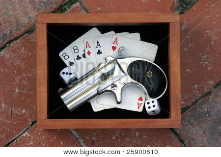 Circa 1889, Model 95, Type II Model 3 Double Derringer in its wooden display box on black velvet with aces and eights aka a