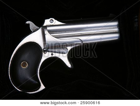 Circa 1889, Model 95, Type II Model 3 Double Derringer on black velvet