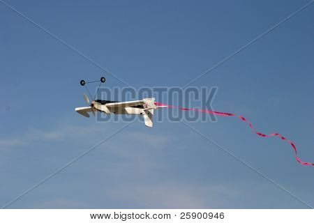 remote controlled airplane zips through the sky