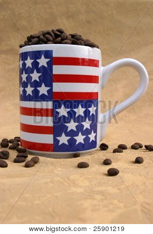 unground coffee beans in and around an American Flag cofee cup on gold background