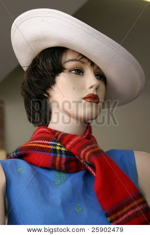 a vintage mannequin in a second hand store