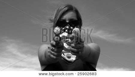 Girl with American Flag bandanna hold squirt guns at You in black and white