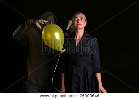 an innocent young woman is about to be attacked by a gas mask wearing fiend