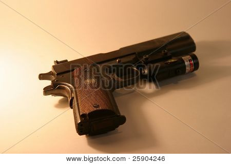 "1911 A1 Colt "".45 ACP"" Pistol with a Laser Site attached"