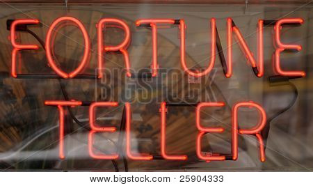 "a neon ""fortune teller"" sign in a window"