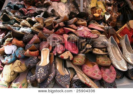 Piles of shoes for sale in a chinese open air market
