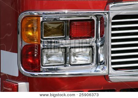 head lights on a fire truck in a parking lot