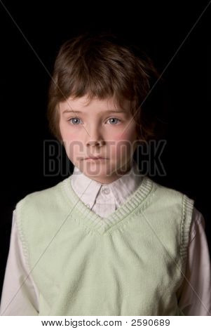 Young Boy In Vest