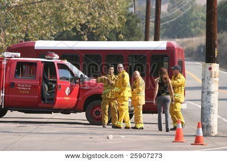 10-23-2007 The Santiago Canyon Fire in california Series. Firemen, Police, Fire Trucks Race to try to save homes and people and pets from the Wild Fires raging out of control
