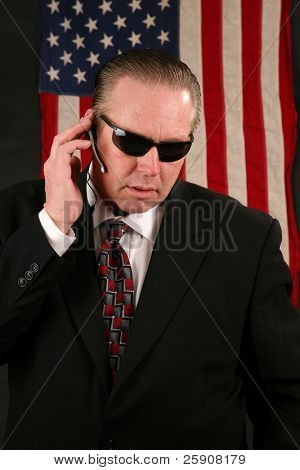 a Secret Service Agent speaks on his ear piece