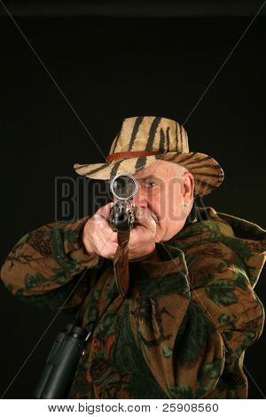 a hunter looks through his Rifle Sight  at YOU THE VIEWER against a black background showing an enlargement of his eyeball
