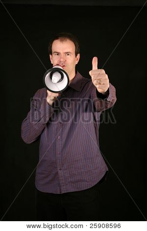 a man makes his demands known by speaking loudly through a megaphone and gives a
