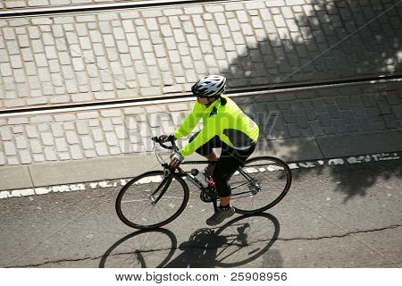 an unidentifiable person on a bicycle rides to their destination