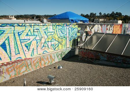 graffiti on the roof of a Tattoo Parlor painted by the artist themselfs so they do not get introuble for destroying other peoples property