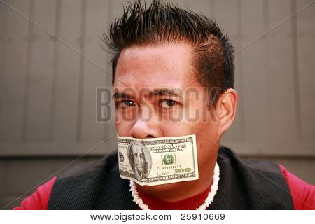 a male model wears a one hundred dollar bill taped over his mouth in protest to represent being silenced by the us economy