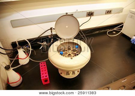 a centrifuge with test tubes and other equipment in a science laboratory